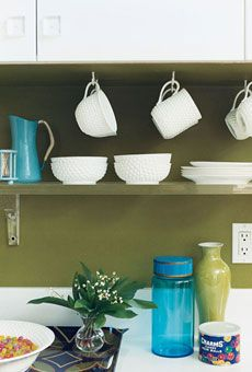 "#shelves #kitchen #colour ""Lucite is both ethereal and subtle, so it doesn't chop the space,"" Kemble says of the shelves and cabinet knobs, adding, ""It also gives a modern feel to a place where it makes sense—the spare kitchen."""