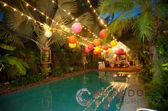 Illuminate your pool party with strings of fairy lights and tropical paper Chinese lanterns for an amazing impact.