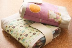 adorable diaper pouches in linen and kokka (tutorial by noodlehead)