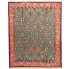 With a distinctive style, a gorgeous wool area rug from Afghanistan will add some splendor to any decor.  This beautiful Soumak Kilim area rug is hand-woven with a floral pattern in shades of teal, pink, gold, and navy.