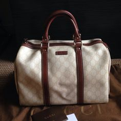 """White Gucci Boston Handbag White GG supreme canvas with brown leather trim, light fine gold hardware, natural cotton linen lining, medium size: 12.6""""W x 8.6""""H x 7""""D. Stored in dustbag. Wear on handles and slight discoloration on bottom with normal use as seen in photos. Gucci Bags"""