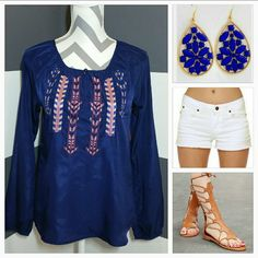 """Bohemian blouse NWOT Beautiful bohemian print navy blue blouse. On the front is an embroidered bohemian design with multicolor trying.   Brand new  size small  100% polyester Length approx 24"""" Bust approx 18.5"""" Loose fit styles Semi bishop sleeve/buttons at end of sleeve Tops Blouses"""