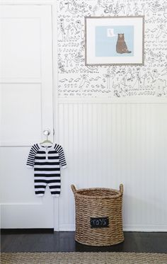 Black and white wallpaper for vintage boy's nursery.