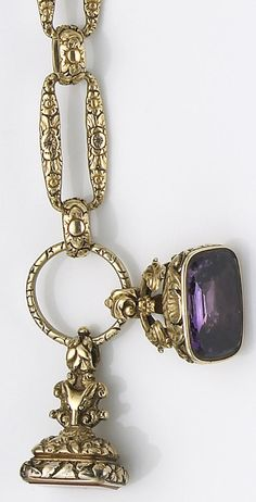 A Georgian, fifteen karat gold and gold-filled watch chain with fobs the gold chain composed of oval links of floral motif, suspending two stone, gold and gold-filled watch fobs; gross weight: 117.00 grams; length: 10 1/2in.