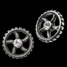 Diamond Crank Wheel Stud Earrings: These Diamond Crank Wheel Stud Earrings symbolize the principle of machine power in the modern age. Hand made in fine English pewter.