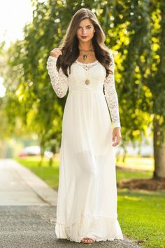 Ivory maxi dress with lace bodice and sleeves! Perfect for a special occasion dress. Simply stunning! Must have!