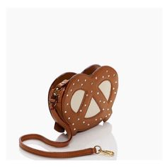 """Kate Spade Pretzel Wristlet Kate Spade far from the tree pretzel wristlet. Smooth cowhide leather with Crystal stones. Zip closure. 12.8"""" approx. total strap length with dog clip closure. Price firm. 52 kate spade Bags Clutches & Wristlets"""