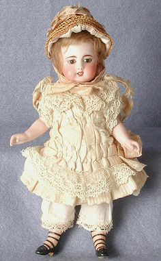 All-bisque doll, girl, ecru lace-trimmed dress, Simon & Halbig, Germany, 1880-1890