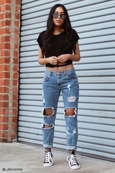 Much like skinny jeans, a pair of boyfriend jeans can be worn with pretty much anything. Dress it up with a pair of fishnet stockings to achieve a more edgier look.