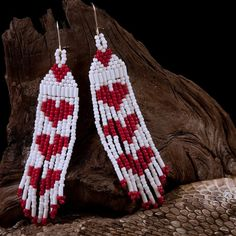 Native American Style Beaded Earrings with Heart Design Artisan crafted with white and red Japanese Seed Beads Silver plated hypoallergenic ear wires Earrings measure wide x long Width measurement is Beaded Earrings Patterns, Seed Bead Patterns, Beading Patterns, Beaded Bracelets, Seed Bead Jewelry, Seed Bead Earrings, Seed Beads, Hoop Earrings, Diy Jewelry