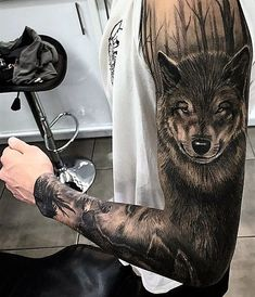 Brilliant full sleeve wolf and forest tattoo.
