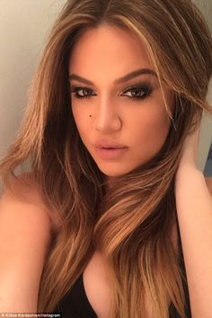 She's going to vamp you: Khloe Kardashian blew her pretty sisters out of the competition by posting her own seductive selfie on Monday