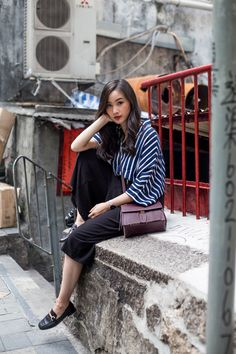 A pinstripe blouse will look great paired with culottes and loafers, as demonstrated by Levi Nguyen. This look is sophisticated yet simple, and will always afford you a classy overall style. Jumpsuit: Zelle Studio, Bag: H&M, Loafers: Charles & Keith. How To Wear Loafers, Loafers Outfit, Biker Chick Style, Selfies, High Waisted Cropped Jeans, Hong Kong Fashion, A New York Minute, New Street Style, Mother Denim