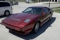 What's the deal with cheesy Pontiac-based replicas?  the 1990 Ferrari 308 Pontiac....