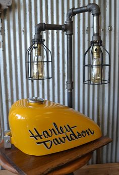 Ive taken a used 1979 - 1982 HARLEY DAVIDSON SPORTSTER FUEL TANK and turned it into a beautiful steampunk inspired table lamp. Set on a base