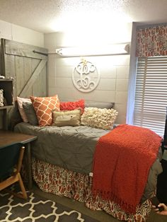 Great Dorm Room - barnwood door headboard, gray and orange, dust ruffle and curtain match