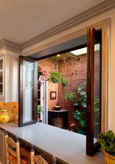 Kitchen window open to patio.