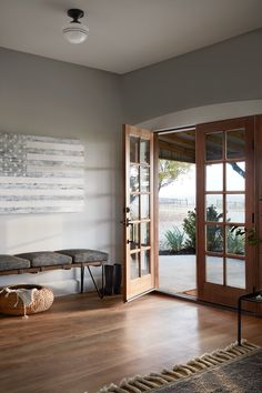 The entry to this home was designed to be warm and welcoming. With the color of the walls and all the natural light coming in through those big french doors I knew that this area of the home would be plenty bright. - July 06 2019 at Fixer Upper, American Farmhouse, Modern Farmhouse, Relax, Interior Decorating, Interior Design, Modern House Design, French Doors, House Styles