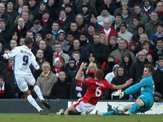 Tomasz Kuszczak (R) and Wes Brown of Manchester United are unable to stop Jermaine Beckford of Leeds United scoring the opening goal during the FA Cup