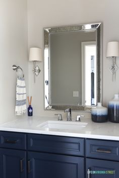 navy Bathroom Decor Neutral powder bathroom with Benjamin Moore Hale Navy navy blue cabinets, chrome star sconces, blue ombre vases, and Daltile One Quartz in the Luminesce. Blue Cabinets, Thermofoil Cabinets, Navy Blue Bathrooms, Home Decor, Hale Navy, Blue Bathroom Vanity, Navy Bathroom Decor, Bathrooms Remodel, Bathroom Decor