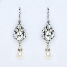 Eye-catching wedding earrings that are not overdone by Haute Bride. Chandelier Earrings, Crystal Earrings, Drop Earrings, Bride Earrings, Wedding Earrings, White Opal, Bridal Accessories, Clear Crystal, Pearls
