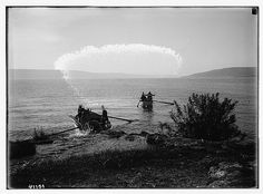 Sea of Galilee & fisherman on north shore.