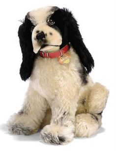 A STEIFF SEATED BUTCH THE COVER DOG, (3330,2), black and white mohair, brown, black and white glass eyes, black stitching, swivel head, red ...