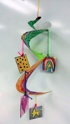 Art with Ms. Gram: Calder Mobiles... love the paper plate ring - great idea.