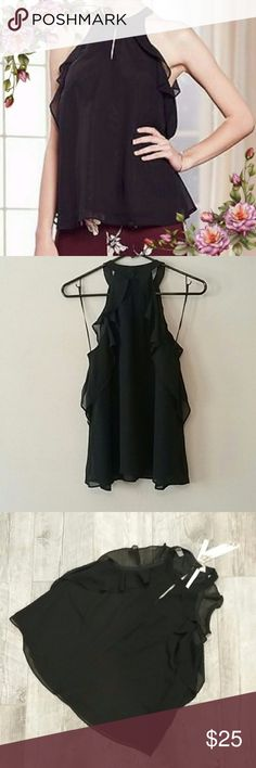 Runway Black Ruffle Keyhole Tank Beautiful black ruffle tank top from the LC Runway line. It has a keyhole neckline with a hook closure in the back. New with tags attached LC Lauren Conrad Tops