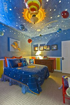 The Solar System inspired toddler's room is filled with hand-painted and ceiling suspended planets, moons, asteroids, comets, and other exciting objects.