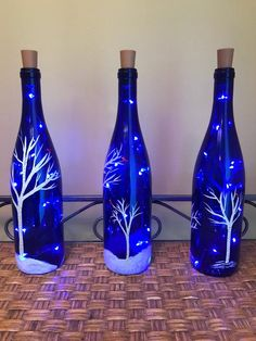 Decorative Bottles Handpainted Lighted Blue Wine Bottle with Birch trees and - Bottles decoration, Wine bottle diy crafts, Blue wine bottles, Painted wine bottles, Lighted wine b - Liquor Bottle Crafts, Wine Bottle Art, Painted Wine Bottles, Lighted Wine Bottles, Diy Bottle, Bottle Lights, Glass Bottles, Blue Bottle, Bottle Trees