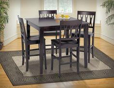 """5 Piece Counter Height Dining Set Abbie Espresso This sleek and stylish couter height dining set can bring life to your dining area with its elegant cut-out detailed seat backs, tapered wood legs, and a deep finish in espresso atop birch solids an basswood veneers. Table Dimensions: Width: 42"""" Depth: 42"""" Height: 37"""""""