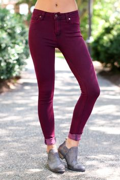 As fine and flattering as these Burgundy Skinny Jeans are, you'll find them to be All Purpose! Casual or a little more dressy, you'll find a way to rock these skinnies! These skinny jeans feature standard 5-pockets design with rivets, a button zipper fly, and belt loops.  • 75% Cotton, 23% Polyester, 2% Spandex  • Machine Wash Cold • Unlined • Made in the USA