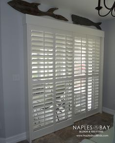 Sliding glass door solution :: Invisible tilt, Plantation shutter sliding panels. :: For more information, contact us :: Naples Bay Blinds + Shutters :: Naples, Florida :: www.NaplesBayBlinds.com