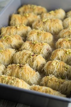 Kataifi is a traditional Greek dessert filled with nuts and covered in a honey syrup. It looks fantastic and will definitely impress your guests! Greek Sweets, Greek Desserts, Arabic Sweets, Greek Recipes, Arabic Food, Arabic Dessert, Rice Recipes, Armenian Recipes, Lebanese Recipes