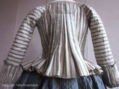 "Back view, ""casaquin"" bodice with "" Watteau"" pleats, France, 1770-1780. Very rare pekin silk jacket/bodice in pale green and pink/salmon stripes on ivory silk ground. The bodice front is attached with two hooks. Elegant ""polonaise"" pleated at the wrists, generous folds ""à la Watteau"" in the upper back. This jacket is fully lined with unbleached hemp. It is partially trimmed with green silk faille ribbon."