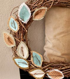 Love how fabric and burlap was used to make the leaves on this wreath!  Gives it a soft touch!