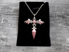 This necklace features a silver plated sword pendant with bat wings. I have hand painted this one with blush pink enamel paint. It has a silver plated chain with lobster claw clasp. You can choose length at checkout. *This is a hand painted item. Sword Necklace, Wing Necklace, Red Pendants, Bat Wings, Beautiful Necklaces, Blush Pink, Hand Painted, Gemstones, Gothic