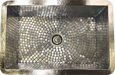 sink -hand-hammered copper which is finished in satin nickel, and the basin features a mosaic pattern created from small stainless steel tiles.