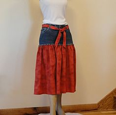 Jeans Skirt   Upcycled Denim and Red Cotton.  I've made 2...one from a skirt that was too short, and another that was   a pair of jean shorts.  the skirt was mine but the rest of the fabric (recycled dresses and shorts) i got at the thrift store.