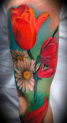I want one like this with sunflowers and roses or peonies going up my leg