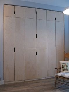 ply wardrobes with quirky cut-out handles - tim & richard germain Built In Furniture, Furniture Design, Bedroom Built In Wardrobe, Eaves Storage, Chalk Hill, Plywood Cabinets, Wardrobe Handles, Kitchenettes, Home Fix