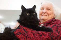 "Bob the cat patiently allows 89-year-old Lois Prince, a resident at Callahan Court Memory Care, to poke and pat him, tug his tail and pick him up. The long-haired black tomcat doesn't even object to being referred to as ""she."" ""She's a good girl. Are you Mama's kitty?"" Prince asked as she hugged her furry friend. Bob, a former stray, is much loved by many Callahan residents. Studies show having a pet can calm Alzheimer's patients, reduce symptoms of post-traumatic stress and more!"