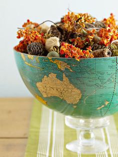 Cut an old globe and turn it into a quirky display bowl to hold potpurri or other items.  Source: Better Homes and Gardens