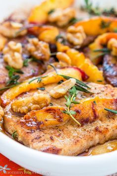 Grilled Pork Chops with Peaches and Walnuts - The easiest and most amazing pork chops ever…ready in 20 minutes! It doesn't get better than that. Just peachy! http://mommyshomecooking.com