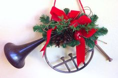 Horn Christmas Wreath with Red Bow and Pine Cones. Beautiful Christmas Wreath with a Horn in the Middle. It is truly Unique. The Horn is the Wreath Decorated.