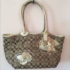 AUTHENTIC Coach Bleecker Floral Signature Tote Floral design is perfect for spring and summer! Gently used with slight wear on the handles, makings inside cloth and flowers.  3 compartments with 2 zipper pockets - one in the middle of the bag and the other on the back pocket. 2 pockets in the front compartment. 1 external pocket on the back.  Snap closure. Coach Bags Shoulder Bags