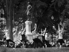 The statue Schuyler Colfax watches over the outdoor yoga class, sponsored by Lululemon athletica  Sunday morning in University Park. The classes will be open to the public every Sunday in June, July and August from 10am to 11am in University Park downtown Indianapolis.  Matt Kryger / The Star