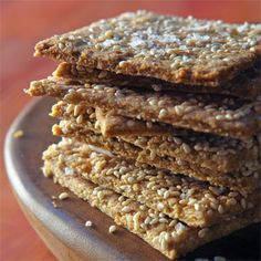 Make your own crackers! These Cheesy Quinoa Crackers are made with olive oil. #glutenfree