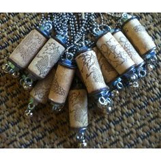 "Each Wine Thirty Cork Necklace is created using recycled wine corks with a grape design, stainless steel ball chain 22"""" - 24' in length and a silver bell to ring (cork designs may vary slightly). Rin"